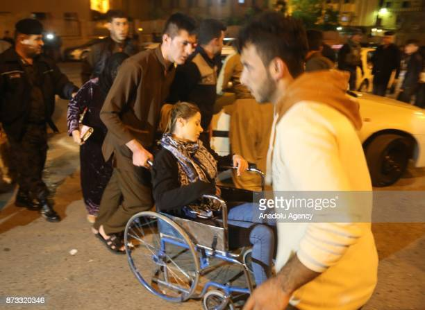 A woman with a wheel chair is seen at Sulaymaniyah Hospital after a 72 magnitude earthquake hit northern Iraq in Sulaymaniyah Iraq on November 12 2017