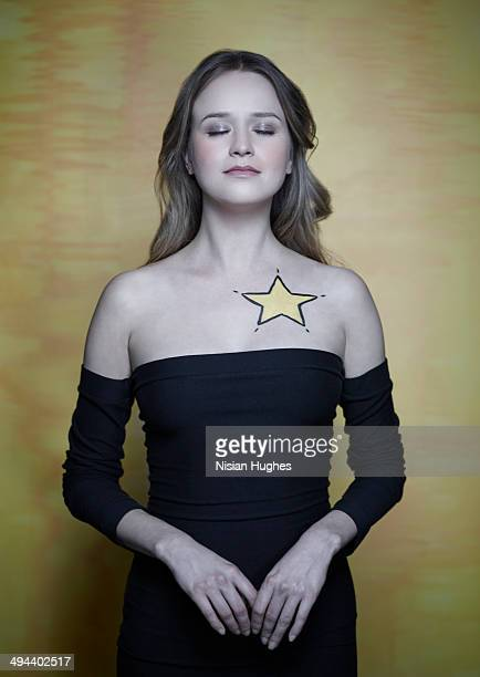woman with a yellow star on her chest - celebrity fake photos stock pictures, royalty-free photos & images