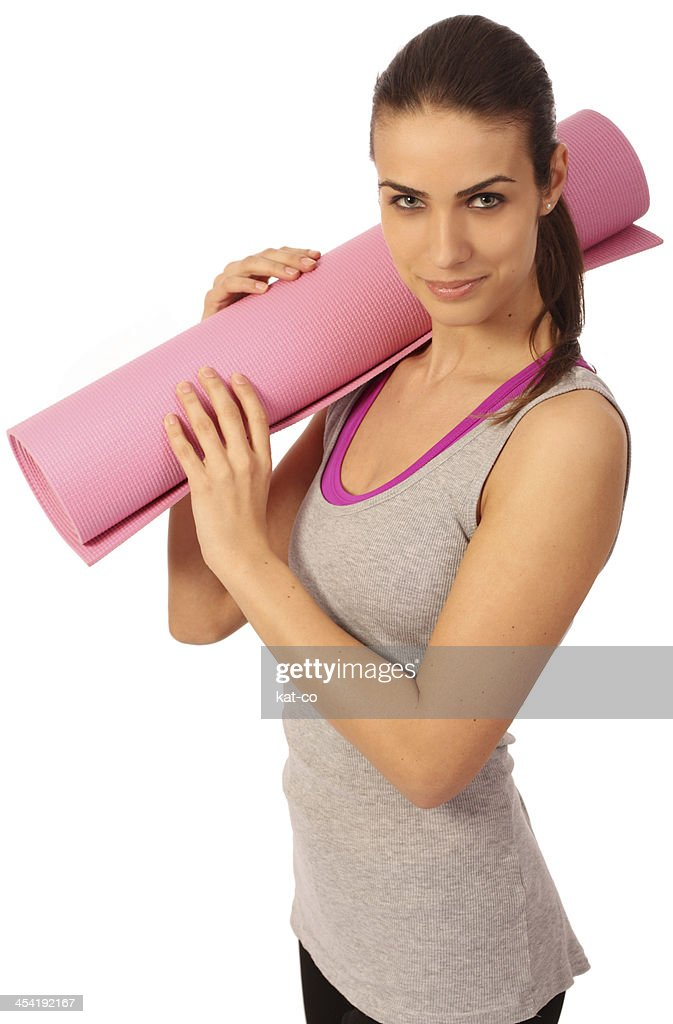 Woman with a yoga mat : Stock Photo