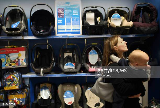 A woman with a young child browses at a Mothercare outlet in Oxford Street central London Friday May 19 2006 Mothercare Plc a UK retailer of...