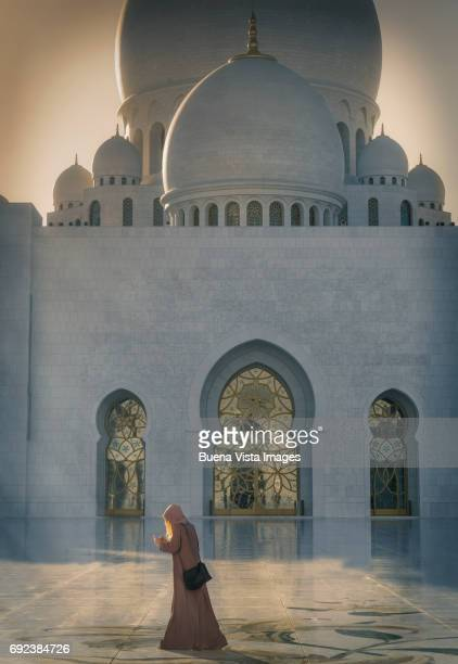 Woman with abaya in a Mosque