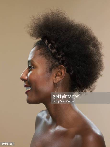 Woman with afro and hoop earrings