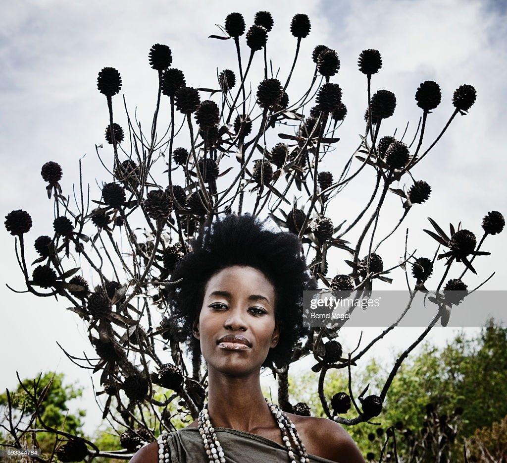 Woman with afro beneath tree : Stock Photo