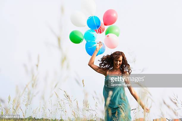 Woman with air balloons walking