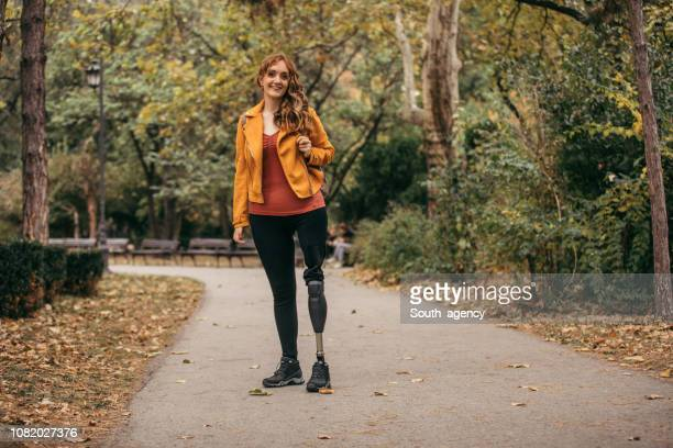 woman with amputee leg - amputee stock pictures, royalty-free photos & images