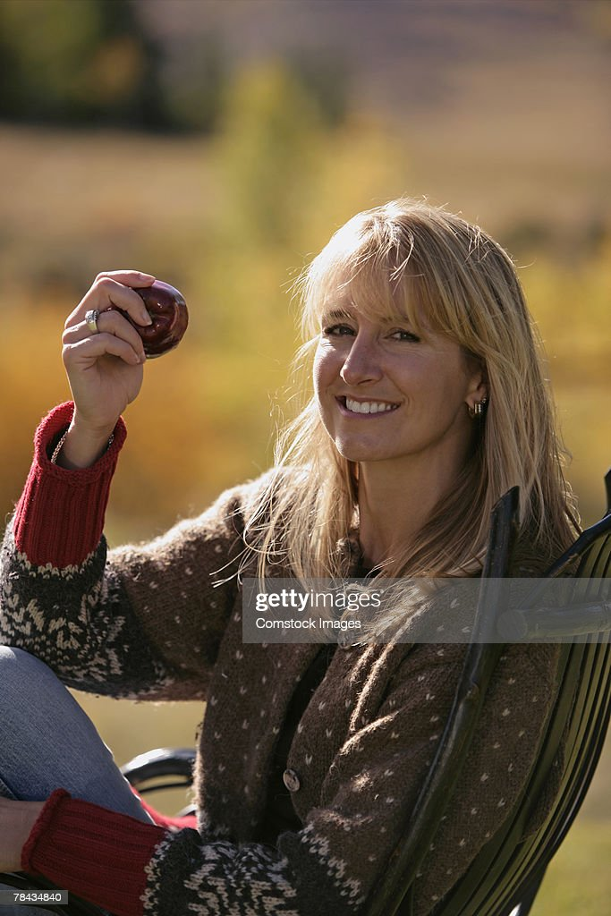 Woman with an apple : Foto de stock