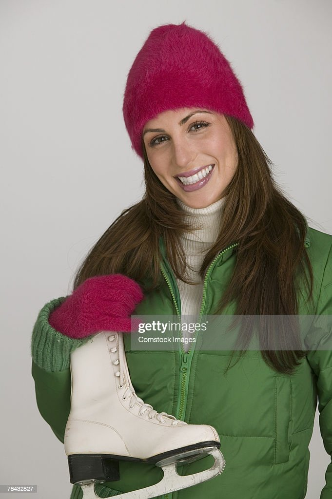 Woman with an ice skate : Foto de stock