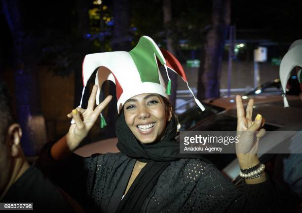 A woman with an Iranian flag colored hat gestures during the celebrations for Iran after the national team qualifies for the 2018 FIFA World Cup by...