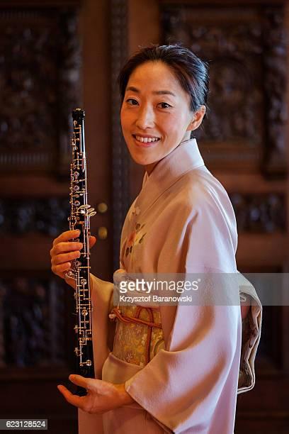 a woman with an oboe - oboe stock-fotos und bilder