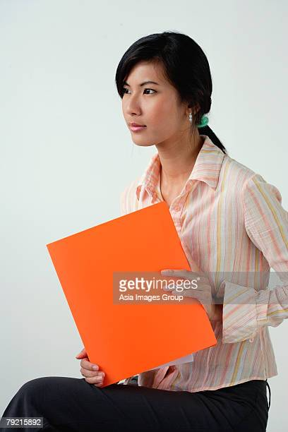 A woman with an orange folder