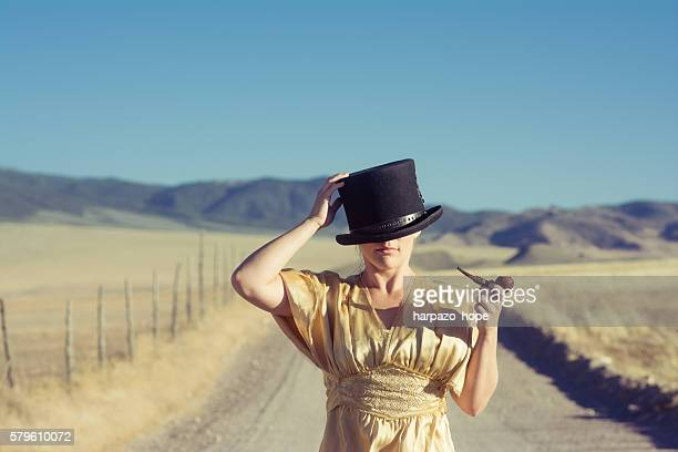 Woman with an over-sized top hat.
