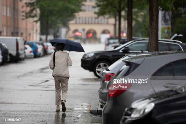 A woman with an umbrella on June 10 in Munich Germany