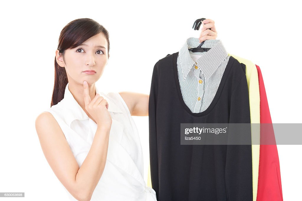 Woman with an uneasy look : Stock Photo