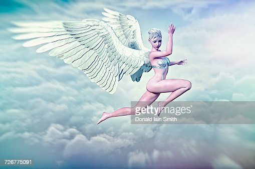 Woman With Angel Wings Flying In Clouds Stock Photo ...