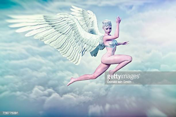 Woman with angel wings flying in clouds