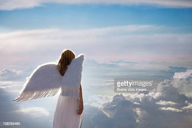 woman with angel wings - heaven stock pictures, royalty-free photos & images