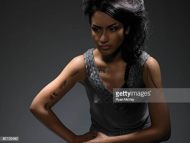 woman with 'anger' written on body