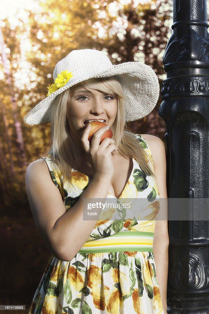 Woman with apple : Stock Photo