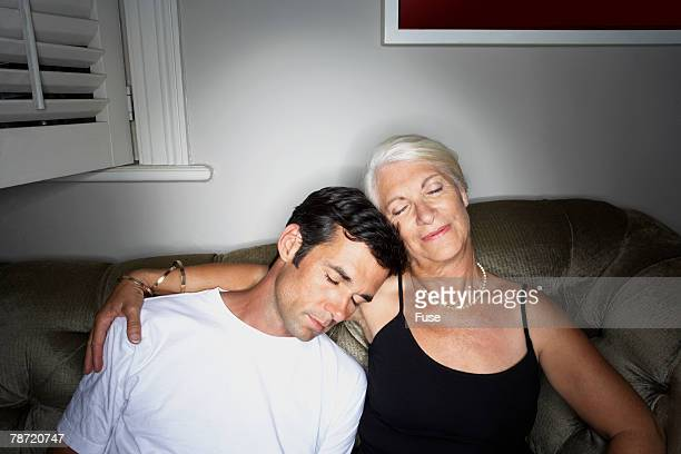 woman with arm around younger man - generation gap stock pictures, royalty-free photos & images