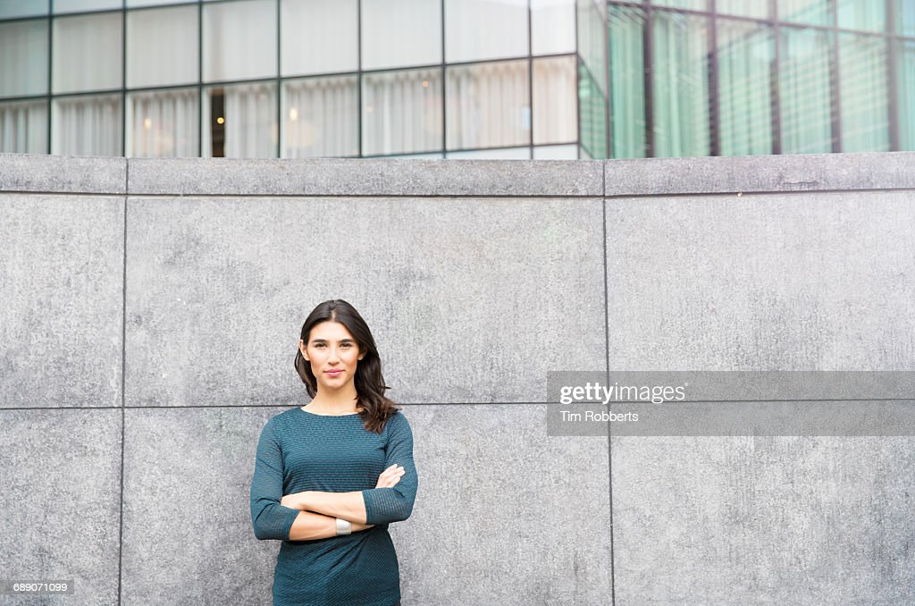 Woman with arms crossed : Stock Photo