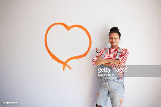 woman with arms crossed renovating room - love stock pictures, royalty-free photos & images