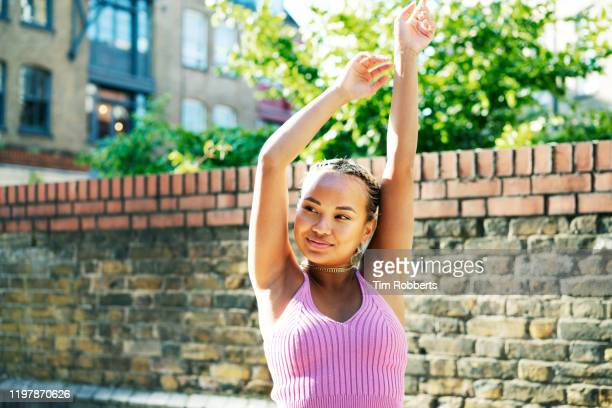 woman with arms in up - arms raised stock pictures, royalty-free photos & images