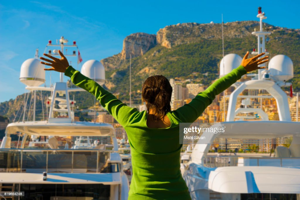 Woman with Arms Outstretched Over Monte Carlo and the Port : Stock Photo