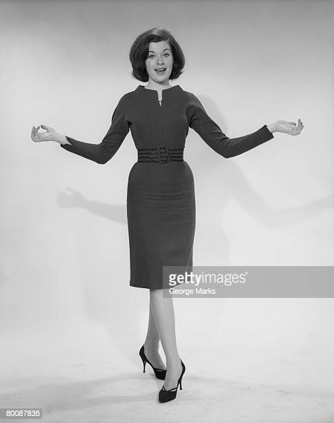 Woman with arms outstretched, portrait