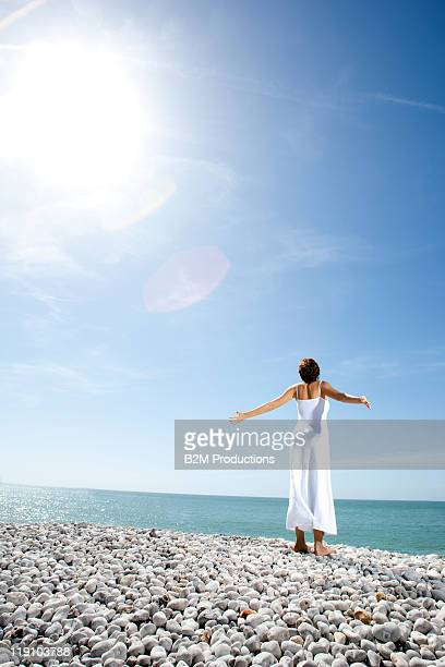 woman with arms outstretched to the sky
