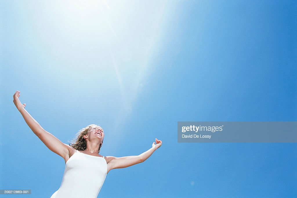 Woman with arms raised : Stock Photo