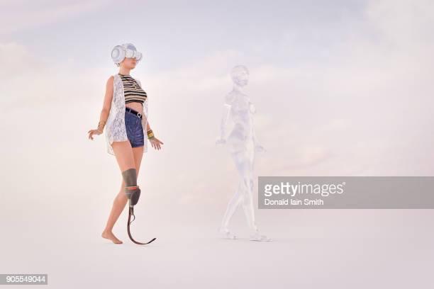 woman with artificial leg wearing virtual reality goggles - beinamputierte frauen stock-fotos und bilder