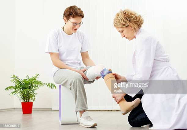 Woman with Artificial Limb at doctors office