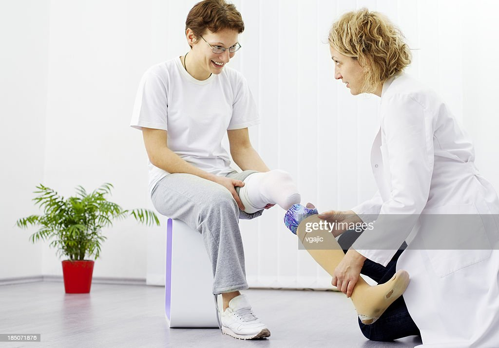 Woman with Artificial Limb at doctors office : Stock Photo