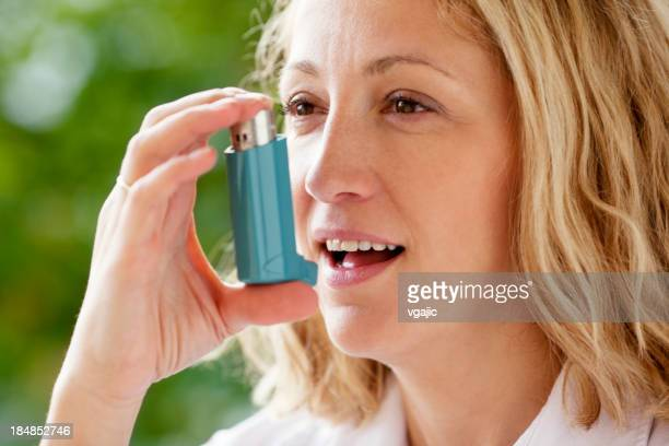 Woman With Asthma Inhaler Outdoor