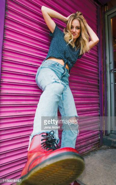 woman with attitude, gritty woman, mean woman, woman kicking, rejection, girl power - posing shoes stock pictures, royalty-free photos & images