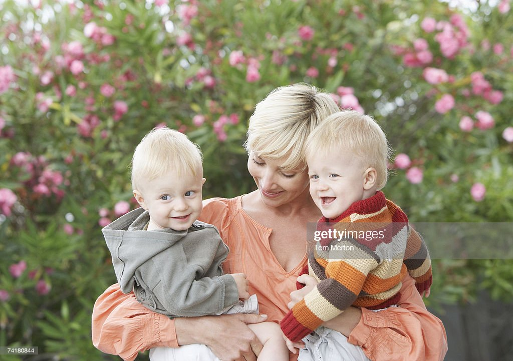 Woman with baby boys : Stock Photo