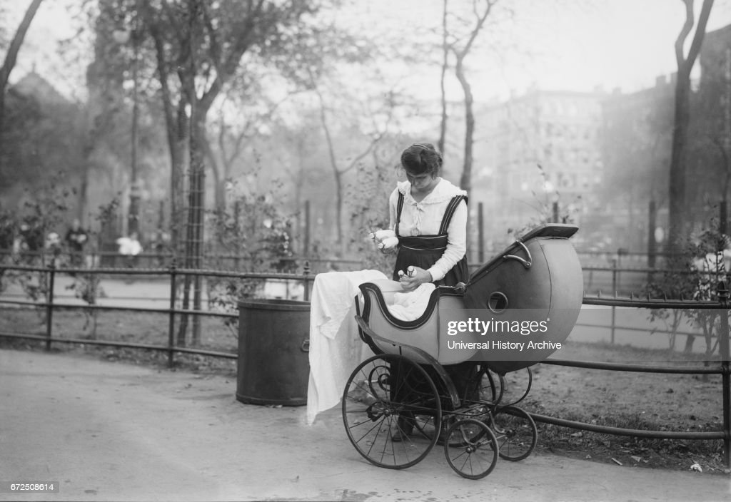 Woman with Baby Carriage Holding Milk Bottles from Depot set up by merchant Nathan Straus that Provides Pasteurized Milk to Poor Families, New York City, 1917 : News Photo