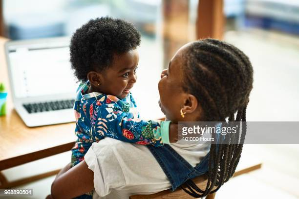 woman with baby son - hairstyle stock pictures, royalty-free photos & images
