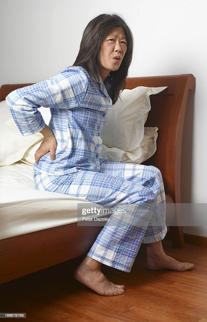 Woman with back ache : Stock Photo