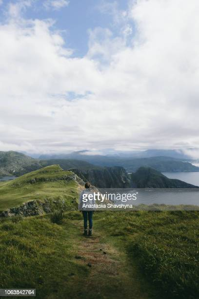 woman with backpack hiking on runde island in norway - lofoten stock pictures, royalty-free photos & images