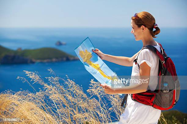Woman with backpack reading map