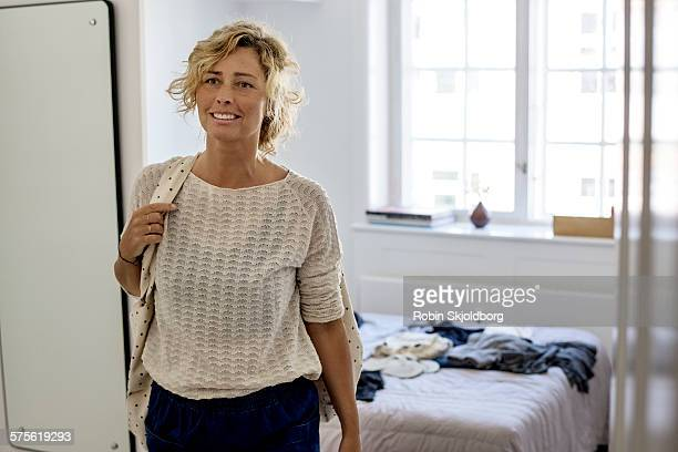 Woman with bag in bedroom