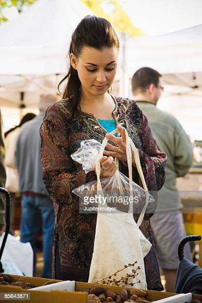 Woman with bag of dates
