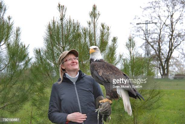 woman with bald eagle - perching stock pictures, royalty-free photos & images