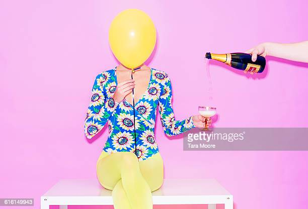 woman with balloon and champagne - incidental people stock pictures, royalty-free photos & images