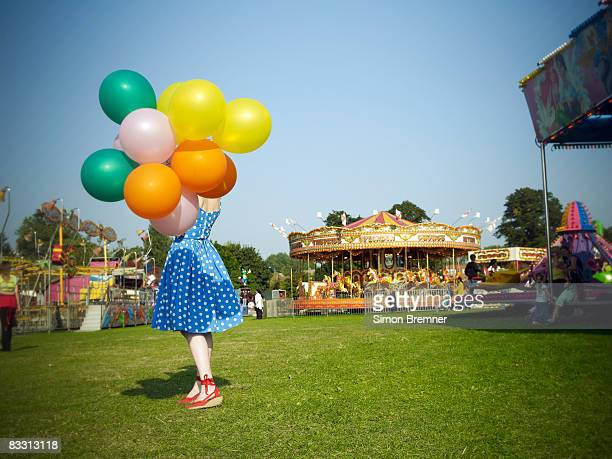 Woman with balloons at fair