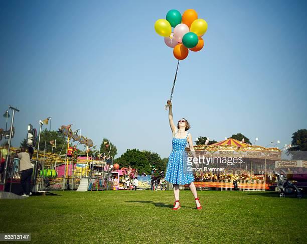 Woman with balloons at fair