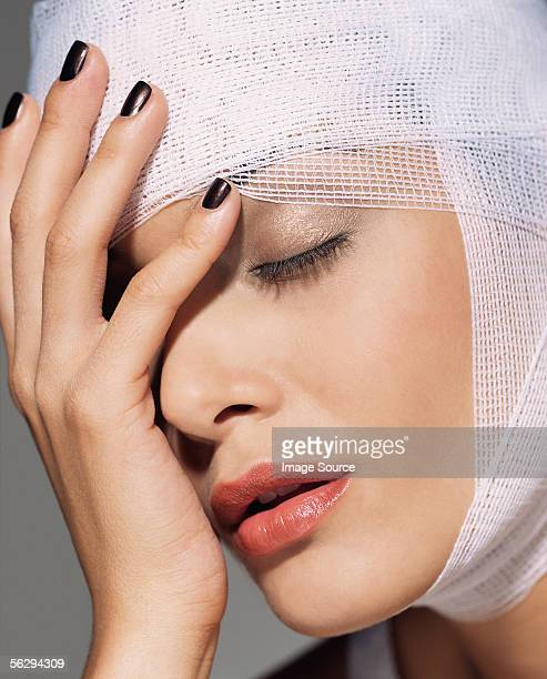Woman with bandage around her head