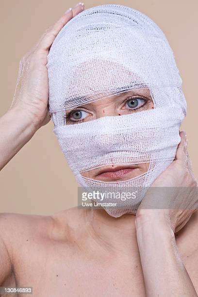 Woman with bandaged face after an operation