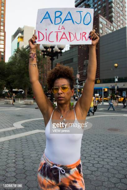 Woman with banner rally in support of Cuban protesters in Union Square Park on July 14, 2021 in New York City. A small group of people gathered in...